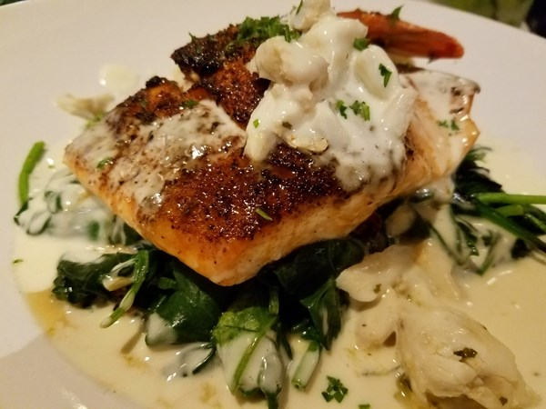 Grilled Salmon Over Garlic Spinach With Crabmeat Lemon Sauce